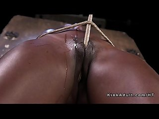 Crotch roped ebony slave endurs pain