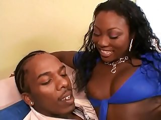 Busty ebony slut Xena fucks a black guy and then gets jizzed on her face