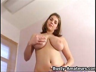 Busty Liana playing with her big juggs and pussy