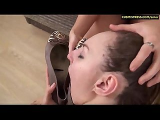 Nasty Russian Mistress enjoys her foot licking session with lesbian slave