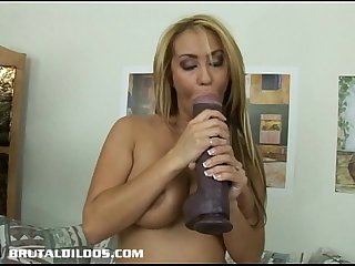 Busty blonde fills her tight ass with a brutal dildo