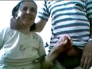 Aged couple having fun on web cam. Amateur