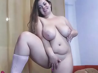 Chubby slut nude standing masturbating on cam