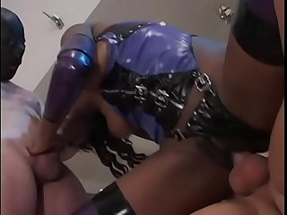 Ebony harlot Promise gets fucked in threesome wearing kinky purple outfit
